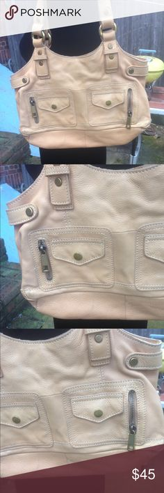 Fossil Bag purse Pocketbook 100% leather Like New Gorgeous Fossil shoulder purse. All leather. Color is that of the 4th photo. Orangey beige. Big enough to hold all essentials. Used once. Extremely clean inside and out. A great addition to your bag collection. Fossil Bags Shoulder Bags