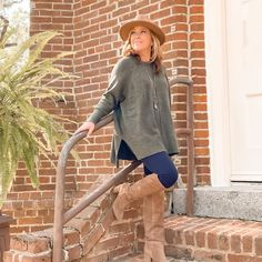Loose sweater, leggings, knee high boots and fedora | For more style inspiration visit 40plusstyle.com