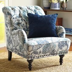 Take a seat in a flowering meadow, offered here in a timeless silhouette. Overstuffed and tufted, this handcrafted armchair comes with vintage charm to spare: Rolled back and arms, ornamental nailhead trim, self-welting and turned hardwood legs. Blue Living Room, Comfy Chairs, Decor, Upholstered Chairs, Furniture, Floral Sofa, Cool Chairs, Floral Armchair, Home Decor