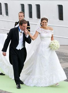 Christopher O'Neill and Princess Madeleine of Sweden depart for the banquet after their wedding ceremony