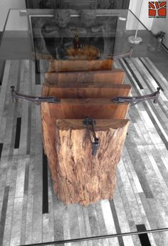 Nativo Redwood. Mesa comedor con base de tronco de madera nativa de Laurel seccionada con soportes de fierro forjado con regulador, con cubierta de cristal de 1.00x2.00x19 mm de espesor. Valor: $1.350.000 A pedido en Av. Camilo Henriquez 3941, Puente Alto. Fono: +56 9 62277920 nativoredwood@gmail.com www.nativoredwood.com Facebook: /nativoredwood Pinterest: /nativoredwood Instagram y Twitter: @NativoRedWood Google +: /nativoredwood