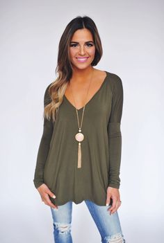 I really like shirts like this. Long enough to wear with leggings and skinny jeans and a little more fun that just plain t-shirt. I have this color but would love other colors!