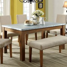This Dining Table Features A Delightfully Natural Appeal With Its Natural  Tone Solid Wood Legs While Showcasing A Galvanized Iron Top.