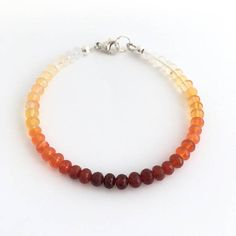 #Stunning #FireOpal #bracelet with Sterling silver. Beautiful #ombré colours from red, through orange and peach to white. A #uniquegift!  This bracelet is made with small, micro facetted, genuine AA Fire Opal rondelles with a Sterling silver clasp. Each stone is unique, varying slightly in size, shape and of course, colour. The stones are approximately 3-5mm in size.  The bracelet will fit a 16-17cm wrist nicely (picture 9), if you would like it adjusted or an extension chain added, please…
