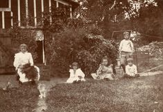 HISTORIC PIC - This 116 year old photograph of five children posed outside their playhouse shows that some pastimes for children remain the same.  This playhouse was on the Stolley Farm, where children today still go to play at what is now Stolley Park in Grand Island.