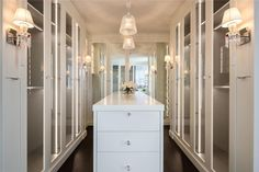 Traditional Closet with Hardwood floors, Built-in bookshelf, European Cabinets, Limestone counters, High ceiling, Wall sconce