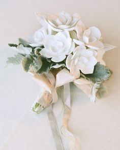 The petals on this crisp, white bouquet are actually made of porcelain