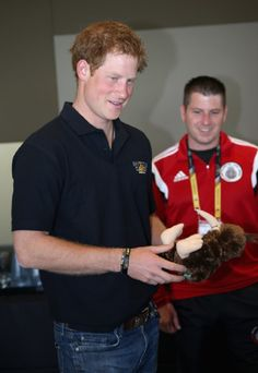 Prince Harry is presented with a team mascot as he welcomes the Team Captains of the 13 nations taking part in the Invictus Games to London at PWC Embankment Place .
