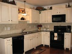 White Kitchen Black Appliances black appliances and white or gray cabinets – how to make it work