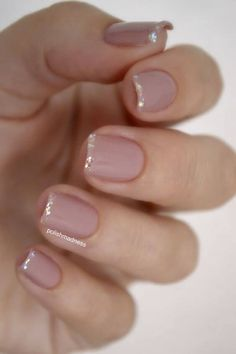 pale pink nails with a thin layer of glitter on the tips