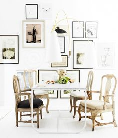 7 Essentials for a Beautiful Dining Space// oversized sconces in a dining room gallery wall
