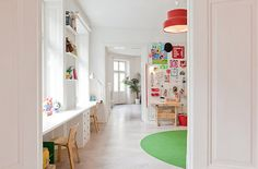 Great idea for the playroom. Desk in front of the windows.