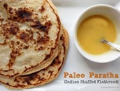 This Paleo Paratha is a stuffed flatbread filled with a spiced cauliflower mixture and topped with ghee. This recipe is the gluten-free version of Gobi ka Paratha – and it tastes just as good as the real thing. Primal Recipes, Gluten Free Recipes, Indian Food Recipes, Low Carb Recipes, Whole Food Recipes, Cooking Recipes, Banting Recipes, Punjabi Recipes, Bread Recipes