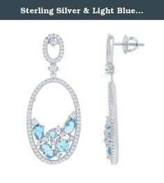Sterling Silver & Light Blue CZ Open Oval Earrings. These stunning pave white cz drop earrings have a cluster of sparkling light blue cz stones nestled with white cz stones inside the lower half of an open oval. The drop dangles from a cz encrusted open oval stud. On sterling silver posts. Rhodium plated to prevent tarnish. Product Dimensions: just over 1-3/4-inch long, 3/4-inch wide earring.