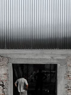 M03 house renovation by BAST contrasts old brick base with new metal extension #architecture #lowcost #corrugated