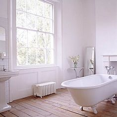 A roll-top bath with all white walls and beautiful wooden floor Laundry In Bathroom, White Bathroom, Simple Bathroom, Bathroom Ideas, Bathroom Plans, Light Bathroom, Bathroom Bath, Laundry Rooms, Bathroom Remodeling
