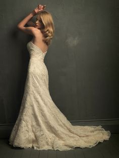 my dress is similar to this. need to figure out what kind of hair style & veil to use