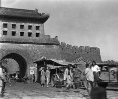 Aloha Wanderwell loved traveling with the expedition through China. Shanghai, Beijing, Hong Kong, all the way along the coast up into Siberia. Here with a crew member and 2 autos at the entrance way to great adventure. What a woman, on a fantastic Journey. NBT  www.AlohaWanderwell.com
