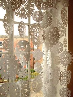 DIY: Airy Escapade ~ Beautiful paper snowflakes cut from simple white paper turn the whole room into a magical, winter wonderland!