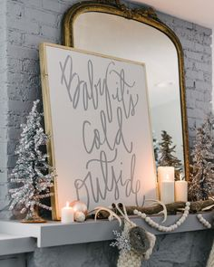 """Last week I shared a glimpse at our mantel and this week I am excited to reveal the whole look! This ""Baby It's Cold Outside"" sign was a must have!! Not…"""