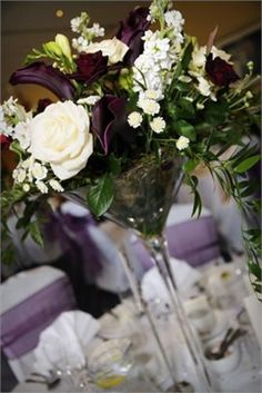 Martini glass flowers. What a stunning idea #centerpeices