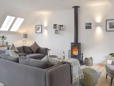 This spacious open plan living area boasts a charming wood burner, ideal for curling up with a book for a lazy afternoon. Cosy Lounge, Living Area, Living Room, Open Fires, Fire Places, Wood Burner, Open Plan Living, Stunning View, Curling