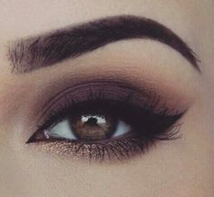 LOVE this perfect smokey eye with a pop of gold!