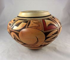 "A large gracefully shaped pottery jar by famed Hopi Indian artist Fannie Nampeyo is an impressive size of 10"" diameter, and it stands 7"" tall."