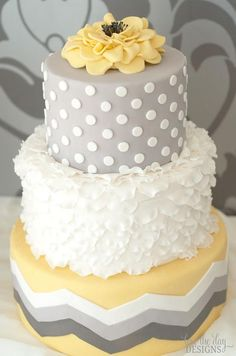 love the combination of grey, yellow and white - and the use of spots, ruffles and chevron stripes with a beautiful yellow fondant flower