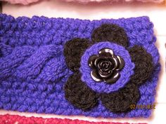 Flowe button matches crocheted flower.