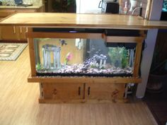 Previous pinner said: This is a 55 gallon fish tank bar that sits in our kitchen. I've added 2 bar stools to sit on. Home Aquarium, Aquarium Design, Aquarium Ideas, Aquarium Ornaments, Aquarium Decorations, Unique Fish Tanks, Fish Tank Stand, Indoor Outdoor Kitchen, Kitchen Room Design