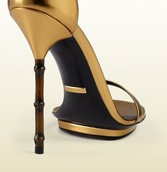 metallic leather sandal with bamboo shaped heel