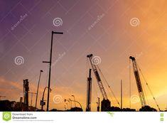 Photo about Cranes silhouettes of subway line over colorful sunset sky. Image of barcelona, subway, progress - 76306134 Sunset Silhouette, Sunset Sky, Crane, Barcelona, Stock Photos, Barcelona Spain