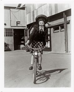 Ginger Rogers rides a bike. {this looks like it was taken during the filming of, The Major and the Minor.}
