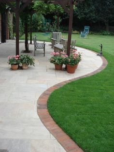 Paving Slab Ideas Cheap Garden Paving Small Patios With . Patios In Havering Essex Outdoor Garden Patio Design. Patio Edging, Brick Edging, Brick Border, Flagstone Patio, Curved Patio, Cement Patio, Small Patio, Patio Slabs, Concrete Bricks