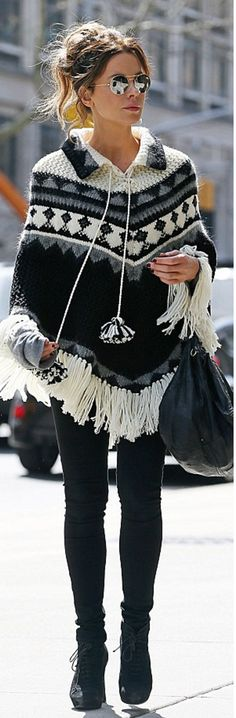 Who made  Kate Beckinsale's black suede boots, fringe white poncho sweater, and leather handbag?