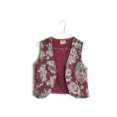 1970s boho hippie floral quilted waistcoat. The perfect combination to layer over your favourite bohemian dress. Cropped and worn open. Made with purple mauve cotton with a floral pattern and quilted. Details Era: 1970s Label: Dorothy Perkins Size: to suit UK 8- 12 Condition: good Bust: Appox 32 -34 Length: 17