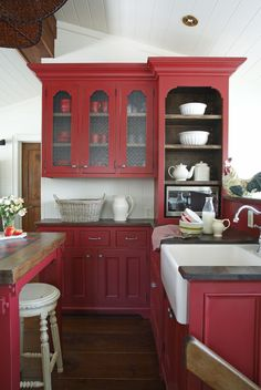 Country kitchen   White farm porcelain sink with open display shelves   Styling by Susan Burns