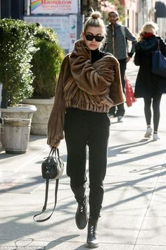Hailey Baldwin wearing Givenchy Micro Nightingale Bag, Celine Cl41468 Edge Sunglasses, Helmut Lang Faux Fur Bomber Jacket in Honey Chestnut and Off-White Combat Boots