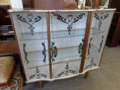 Glass China Cabinet With Decorative Trim And Glass Shelves ---  H - 95cm W - 99cm D - 30cm £10 (PC449)