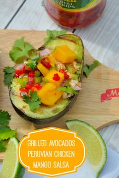 Grilled Avocados with Peruvian Chicken and Mango Salsa- spiced chilled chicken and sweet mango salad over creamy, hot avocados. Can you believe it only takes 15 minutes to prepare??
