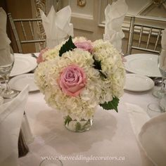 Low table centrepieces using white hydrangeas & blush roses.