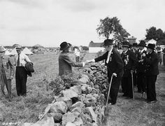Confederate and Union soldiers shake hands across the wall at the 1938 reunion for the Veterans of the Battle of Gettysburg.