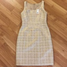 NWT Banana Republic gold houndstooth sheath Absolutely beautiful fitted cream and metallic gold sheath--never worn, been hoping I'd eventually fit into it, but it's time to move on! Banana Republic Dresses