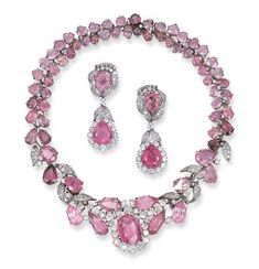 A SUITE OF PINK TOURMALINE AND DIAMOND JEWELLERY, BY WEBB    Comprising a necklace, set with an oval-cut tourmaline in an old-cut diamond partial surround, to the pear-shaped tourmaline front section enhanced by pavé-set diamond foliage with old and single-cut diamonds, to the pear and heart-shaped tourmaline two-row backchain; and a pair of ear pendants en suite, mounted in platinum
