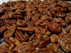 Sugar-Free Candied Nuts  (includes discussion of various sweeteners to sub)  2 ½ cups nuts of choice  1 egg white  ½ cup Splenda granular or other sweetener  1 1/2 teaspoons cinnamon  1/8 teaspoon salt    Preheat oven to 300 degrees. Line a 15x10x1 inch pan with foil and spray with cooking oil. Place nuts in a bowl. Beat egg white in a separate bowl until foamy and stir into the nuts until evenly coated. Sprinkle Splenda, cinnamon, and salt over the nuts. Bake in dollops approx 30 minutes.