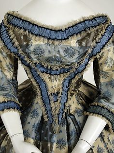 Dinner dress Date: 1855–59 Culture: British Medium: silk, cotton Dimensions: Length at CB (a): 13 in. (33 cm) Length at CB (b): 48 1/2 in. (123.2 cm)