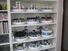 #papercraft #Crafting supply #organization. Using lazy susans on bookshelves to arrange paints, sprays, stains and various powders.