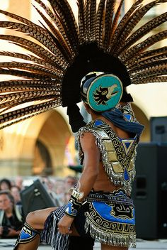 A performer from Mexico does a dance in Aztec costume at the International Student Folklore Festival by thaths, via Flickr