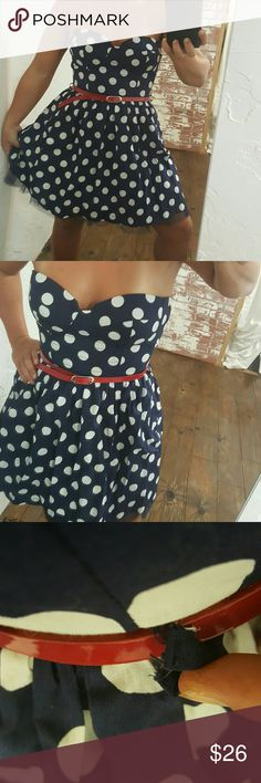 Love Culture Polkadot Party Dress Brand new with tags never worn. Red pleather belt included as well as optional bra straps. Corset boned brasier top, zip up back, adorable tulle skirt liner. Fits about size 4/6 Love Culture Dresses Strapless